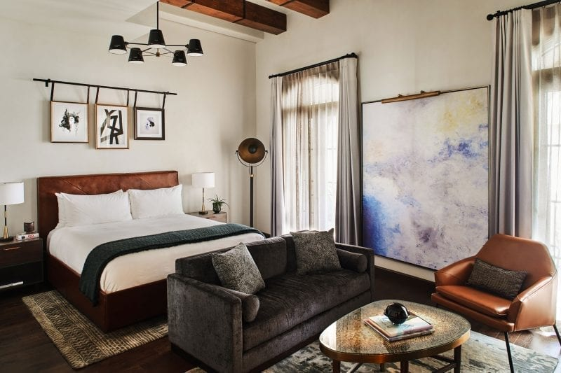 hotel room with bed, sofa, chair and coffee table