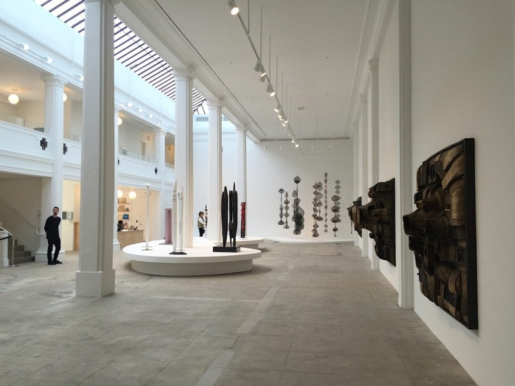 art exhibition hall with sculptures