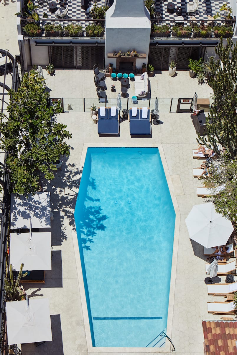 overhead view of hotel pool and surrounding lounge area